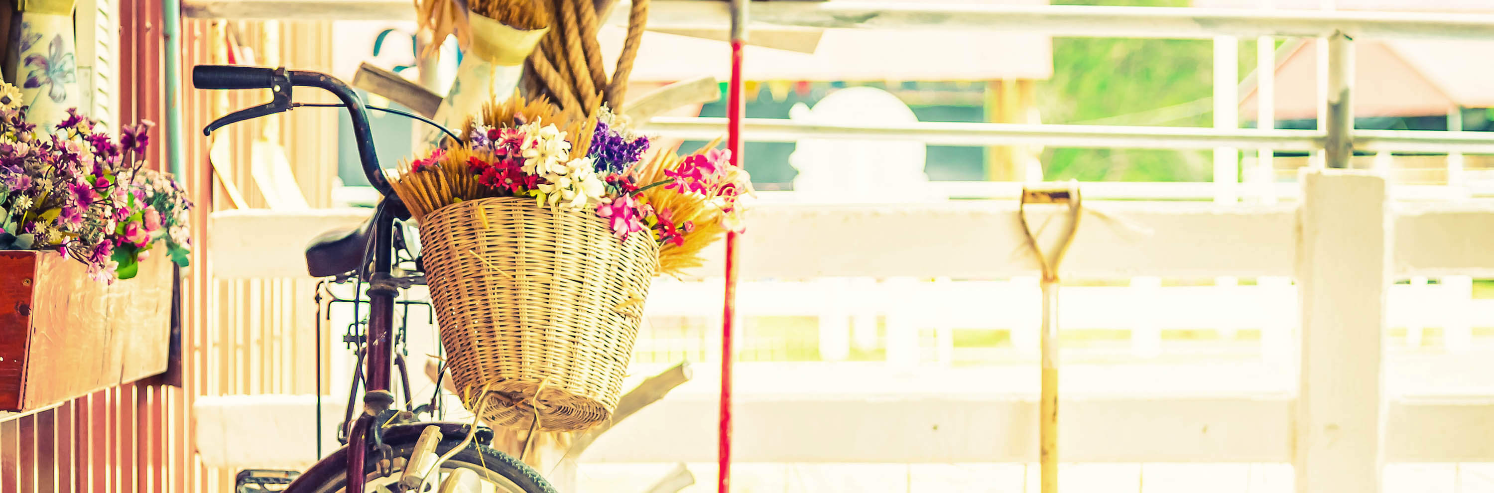 Vintage bicycle with flower on basket - vintage filter